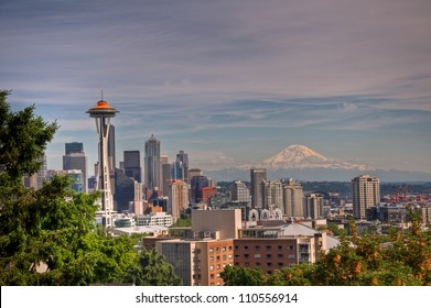 A daytime view of downtown Seattle and the Space Needle with Mt. Ranier in the background.