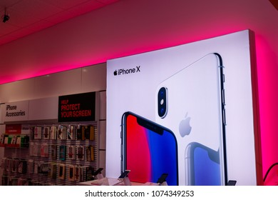 Dayton - Circa April 2018: iPhone X display at a T-Mobile wireless store. T-Mobile upgraded hundreds more cell sites with mid-band LTE capacity IV