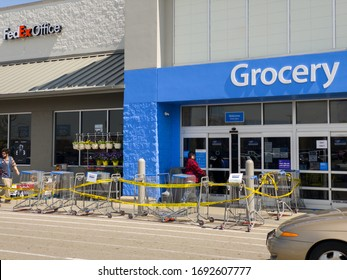 DAYTON, OH - APRIL 2: Walmart entrance with controlled line entering building due to Coronavirus quarantine in Dayton, Ohio on April 2, 2020.