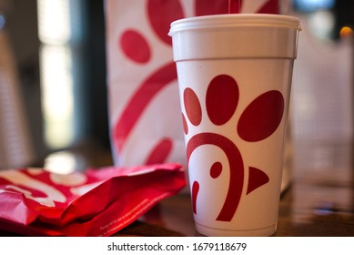Dayton, OH- Mar 16, 2020; chick fil a food item flat lay on wooden table