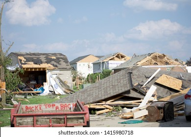 Dayton, OH- May 27, 2019: Memorial Day Storm Damage in Beavercreek (Dayton) Ohio. Damage Includes ripped off roofs, attics opened, cars destroyed, garages split, trees split
