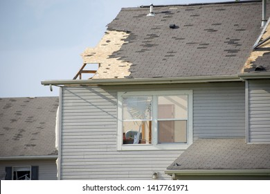 Dayton, OH- May 27, 2019: Memorial Day Storm Damage in Beavercreek (Dayton) Ohio. Damage Includes ripped off roofs, attics opened, cars destroyed, garages split, walls broken, house interiors visible