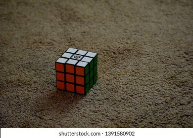 Dayton, OH- May 7, 2019: Solved Rubix Cube Isolated Sitting on a Tan Carpeted Floor