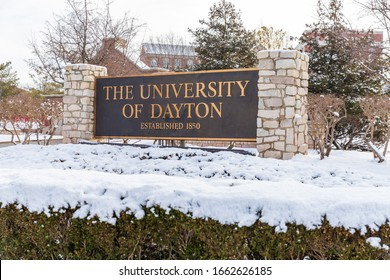Dayton, OH, USA / February 28, 2020: University of Dayton sign, with fresh winter snow on the ground.