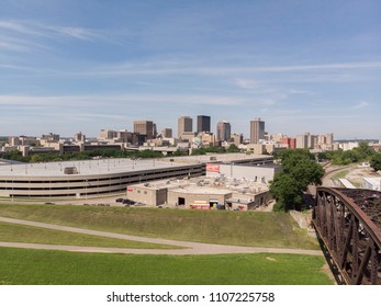 DAYTON, OHIO - JUNE 6: Downtown city seen from Miami River near industrial railroad bridge of Dayton, Ohio on June 6, 2018.