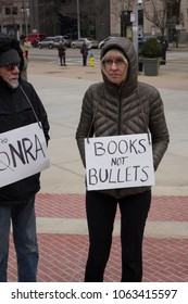 DAYTON, OHIO - MARCH 24: 'Books not bullets' and 'No to NRA' signs at March for Our Lives gathering in downtown Dayton, Ohio on March 24, 2018.