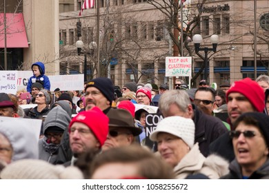DAYTON, OHIO - MARCH 24: Crowd of people with signs at March for Our Lives gathering in downtown Dayton, Ohio on March 24, 2018.