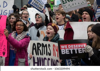 DAYTON, OHIO - MARCH 24: Crowd of people holding signs at March for Our Lives gathering in downtown Dayton, Ohio on March 24, 2018.