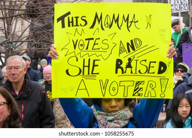 DAYTON, OHIO - MARCH 24: Proud voting mother holds sign at March for Our Lives gathering in downtown Dayton, Ohio on March 24, 2018.