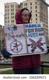 DAYTON, OHIO - MARCH 24: Woman holding March For Our Lives sign during gathering in downtown courthouse square Dayton, Ohio on March 24, 2018.