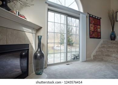 Dayton, Ohio - November 28, 2018: Snowy winter scene as seen through living room glass patio doors.