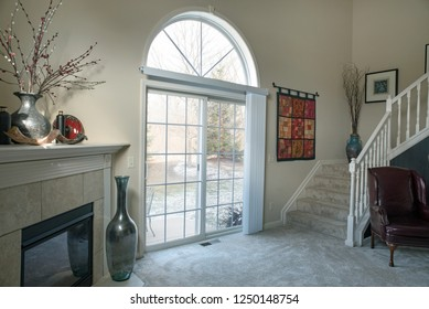 Dayton, Ohio - November 28, 2018: Living room with winter scene as seen through glass patio doors.