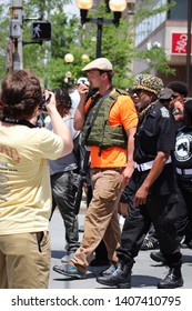Dayton Ohio USA, May 25, 2019: A group of Black Panther Party members, along with a member carrying an AR15 rifle at the anti-KKK rally downtown.