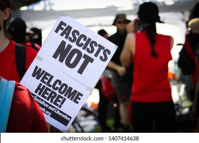 Dayton Ohio USA, May 25, 2019: A protester holds an anti-fascist sign on the way to the anti-KKK rally.