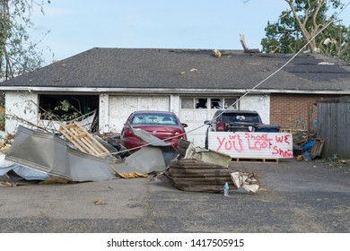 Dayton, Ohio, USA May 29, 2019: 'You loot We shoot' written on piece of debris after tornado