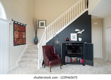 Dayton, Ohio, USA - November 19, 2018: Townhouse condominium living room with black accent wall with open TV cabinet.