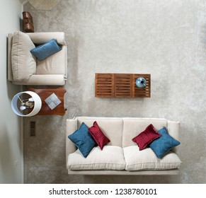 Dayton, Ohio, USA - November 23, 2018: Looking down on contemporary living room arrangement in neutral tones with colorful pillows.