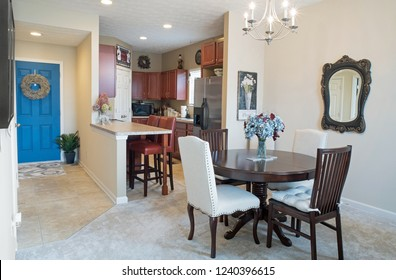 Dayton, Ohio, USA - November 23, 2018:  Condo open living concept with dining area, galley kitchen and entrance with blue door.