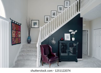 Dayton, Ohio, USA - November 27, 2018: Townhouse condominium's black wall & open stairway with red accents.