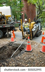 DAYTON, OHIO, USA - OCTOBER 25, 2016: Worker operates horizontal directional drill to replace steel or cast iron pipes with new plastic gas lines in a residential area for Vectren Energy Delivery.