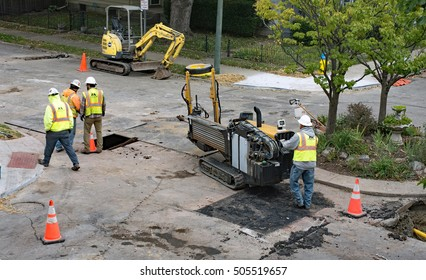 DAYTON, OHIO, USA-OCTOBER 25, 2016: Workers relocating horizontal directional drill while working in residential area to replace steel or cast iron pipes with plastic pipe for Vectren Energy Delivery.