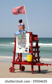 DAYTONA BEACH, FL - CIRCA 2009:Unidentified female lifeguard scans the surf for emergencies circa 2009 in Daytona Beach.  The Beach is widely considered the shark bite  capital of the world.