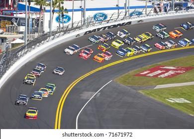 DAYTONA BEACH, FL - FEB 20: Kurt Busch (22) takes his Pennzoil Dodge down the frontstretch during the Daytona 500 race on Feb 20, 2011 at the Daytona International Speedway in Daytona Beach, FL.