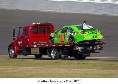 DAYTONA BEACH, FL - FEB. 23: Danica Patrick (10) spins off of turn 2 and wrecks during the Gatorade Duel 1 race at the Daytona International Speedway in Daytona Beach, FL on Feb 23, 2012. Her car is towed off the track.