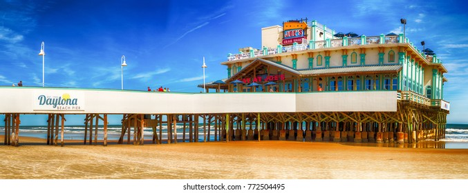 DAYTONA BEACH, FL - FEBRUARY 17, 2016: Daytona Beach Pier on a beautiful day. The city is a famous tourist attraction.