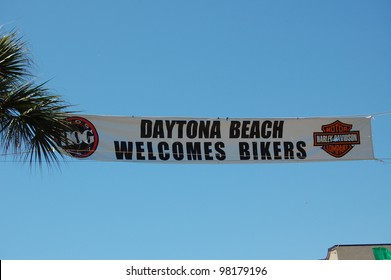 """DAYTONA BEACH, FL - MARCH 17:  Welcome banners hang across Main Street amid the sea of bikers in town for """"Bike Week 2012"""" in Daytona Beach, Florida. March 17, 2012"""
