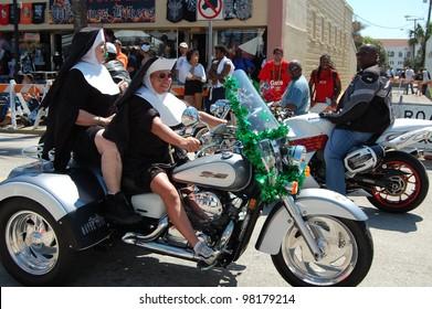 "DAYTONA BEACH, FL - MARCH 17:  Bikers get creative dressed as nuns cruising Main Street during ""Bike Week 2012"" in Daytona Beach, Florida. March 17, 2012"