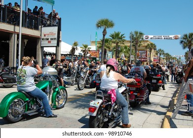 "DAYTONA BEACH, FL - MARCH 17:  Bikers cruise Main Street on St. Patrick's Day during ""Bike Week 2012"" in Daytona Beach, Florida."