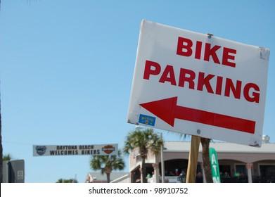 "DAYTONA BEACH, FL - MARCH 17:  Signs and banners help the bikers navigate Main Street during ""Bike Week 2012"" in Daytona Beach, Florida."