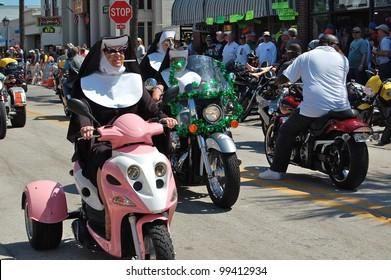 "DAYTONA BEACH, FL - MARCH 17:  Bikers get creative as they cruise Main Street dressed like nuns during ""Bike Week 2012"" in Daytona Beach, Florida."