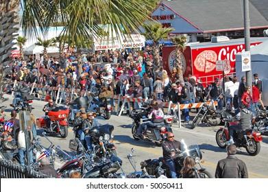 "DAYTONA BEACH, FL - MARCH 6:  Bikers cruise Main Street during ""Bike Week 2010"" in Daytona Beach, Florida."