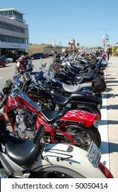 "DAYTONA BEACH, FL - MARCH 6:  Motorcycles line Beach Street for miles during during ""Bike Week 2010"" in downtown Daytona Beach, Florida."