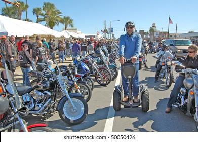 "DAYTONA BEACH, FL - MARCH 6:  A lone Segway glides down Beach Street amid the sea of bikers in town for ""Bike Week 2010"" in Daytona Beach, Florida."