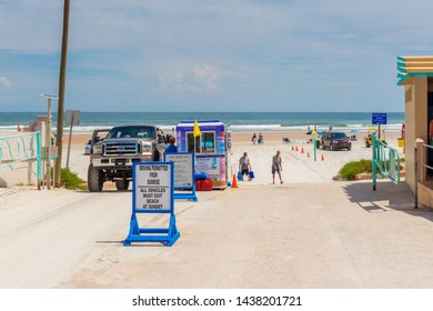 Daytona Beach, FL, USA - April 2, 2015: Car entrance at Daytona Beach, Florida, USA. Daytona beach is historically known for its beach where motorized vehicles are permitted to drive.