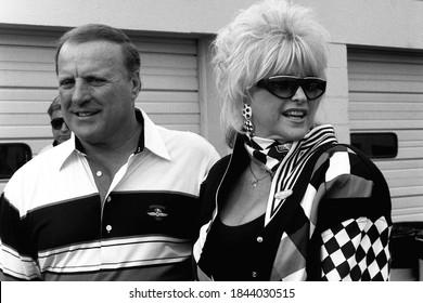 Daytona Beach, FL / USA - February 11, 1992: A vintage, black-and-white photo of legendary race car driver A.J. Foyt and Ms. Hurst, Linda Vaughn, at Daytona International Speedway in Florida.
