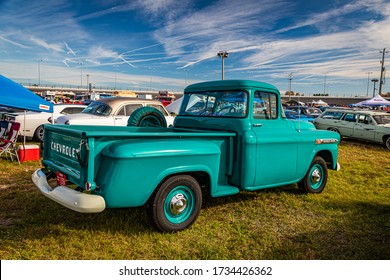 Daytona Beach, FL / USA- November 24, 2018: Green 1959 Chevrolet Apache pickup truck at the Fall 2018 Daytona Turkey Run.