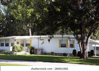 DAYTONA BEACH, FL-MAY, 2015:  Older mobile home in a retirement community is well cared for with nice landscape.