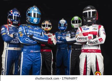 DAYTONA BEACH, NC - FEB 19, 2014:  Trevor Bayne, Ricky Stenhouse, Jr., Greg Biffle, Carl Edwards, Chris Boucher, Ryan Reed pose at the Daytona International Speedway in Daytona Beach, FL.