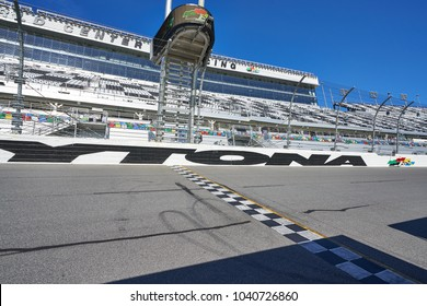Daytona, Florida/USA - January 16 2018: The ending finish line at a racetrack in Florida. The asphalt pavement has skid marks from cars racing past.