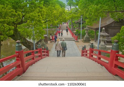 Dazaifu, Fukuoka, Kyushu, Japan - May 17th ,2015 : Taikobashi Red Bridge in Dazaifu temple garden ,across over Shinji pond leading to Dazaifu Tenmangu Shrine entrance ,where is famous shinto shrine.