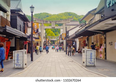 Dazaifu, Fukuoka, Kyushu, Japan - May 17th ,2015 : A stone Torii Gate along the Dazaifu shopping street ,leading to Dazaifu tenmangu shrine entrance ,where is a famous ancient shinto shrine in Fukuoka