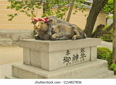 Dazaifu, Fukuoka, Kyushu, Japan - May 17th ,2015 : The Lying down Sacred Cow Statue call in japanese is nade ushi ,which is symbol of Dazaifu Tenmangu Shrine ,where is a famous shinto temple landmark