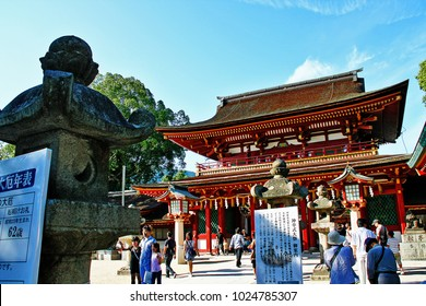 Dazaifu, Fukuoka, Kyushu, Japan - September 20, 2009 - People come to pray and worship at Honden, or main shrine, of Dazaifu Tenman-gu