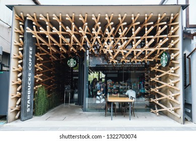 Dazaifu, Japan - June 9, 2016: Tourists are visiting Starbucks Dazaifu, the unique architectural design Starbucks, near Dazaifu Tenmangu Shrine entrance, Japan