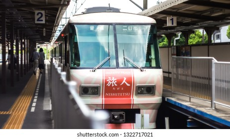 Dazaifu, Japan - June 9, 2016: :The local diesel train at a platform in Dazaifu Train station.There are many tourists traveling by train for look around.That's comfortable transportation.