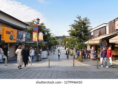 Dazaifu, Japan - November 19, 2018: Many tourists are walking along shops and stored near Dazaifu Tenmangu Shrine entrance, Japan